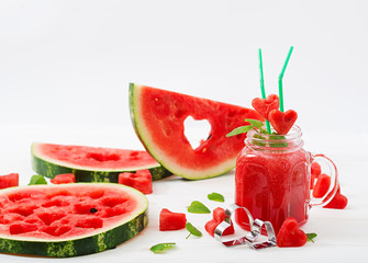 Fresh watermelon smoothies with mint on white wooden background.