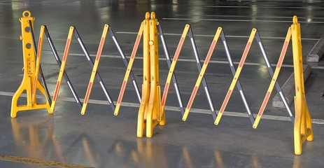 Yellow Portable Plastic Barriers Blocking The Road