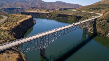 Poster Bridge High bridge over the Boise river reservoir in summer