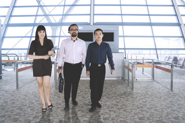 Business people walking in the airport terminal