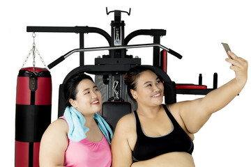 Two fat women taking selfie after exercise