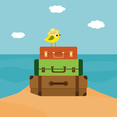 Little bird sitting on the stack of suitcases