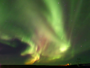 Spectacular Northern Lights Flashing on the Autumn Sky of South Iceland
