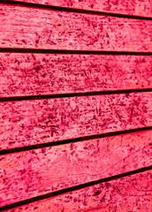 Magenta grungy wooden background.