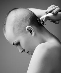 Girl shavinng her head