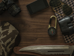 Accessories adventure , knife, camera, compass, sunglasses, scarf.