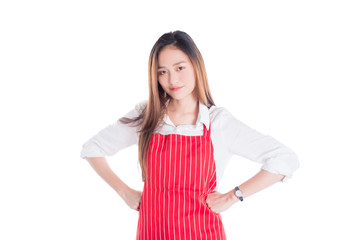 Beautiful asian woman wearing red apron and looking at camera