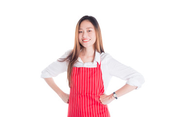 Beautiful asian woman wearing red apron looking at camera and smiles