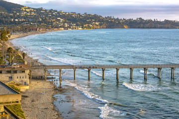 Scripps pier, beach and coastline near the end of the day at golden hour