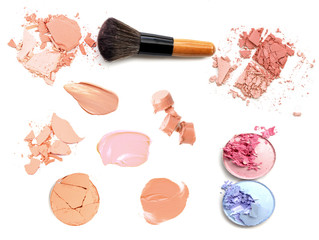 collection of various make up lipstick and powder strokes on white background