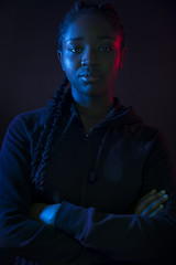 Dark colorful portrait of confident african woman with dark skin