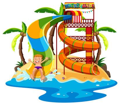 Little boy playing waterslide