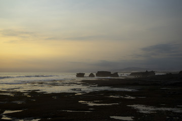 The Tanah Lot Temple at sunset, the most important indu temple of Bali, Indonesia.