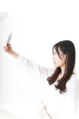 Young woman taking Selfie photos