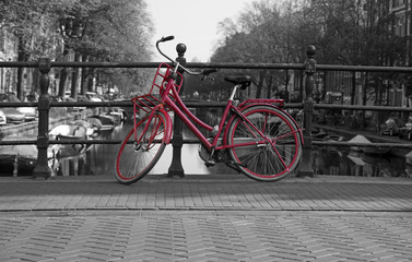 Black and white view of Amsterdam with redbicycle