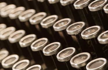 Close up of old, dusty typewritter keys with copy space