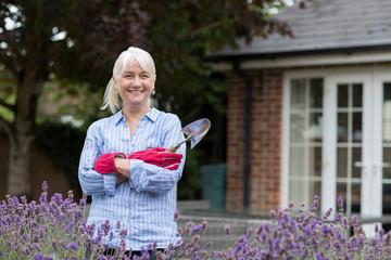 Portrait Of Mature Woman Working In Garden