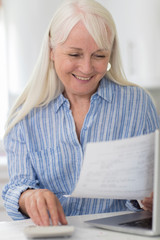 Smiling Mature Woman Reviewing Domestic Finances