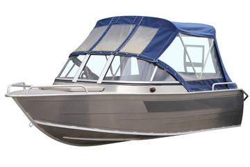 Boat with blue canvas top.