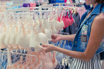 Woman chooses a brassiere in a shopping mal of tropical island Bali, Indonesia.