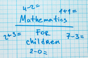 """The word """"mathematics for children"""" with tasks in a notebook for drawing."""