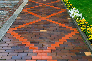Beautiful pavement of red and brown clinker brick. Walking path Wall mural