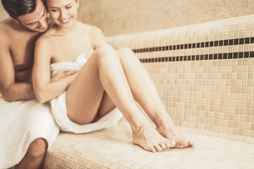 Young couple relaxing inside spa sauna turkish bath - Two lovers enjoying vacation in luxury resort hotel - Relationship, love, sex  and travel concept - Soft focus on woman feet - Vintage filter