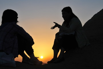 two girls watching sunset at Cappadocia, Turkey