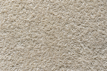 Beige Towel Texture Background. Texture of a beige towel or carpet