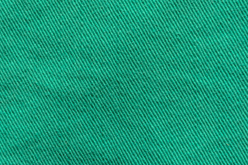 Green Denim Textile Texture Close-up. Macro Snapshot of Tissue Structure