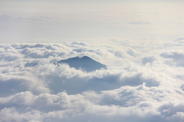 Mountain peak above sea of clouds.