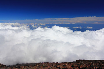 Clouds above mountain high and blue sky