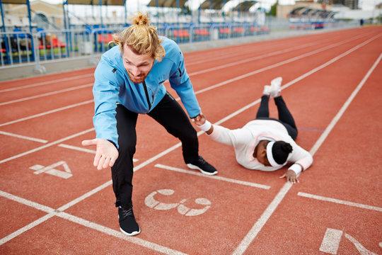 Dragging female towards finishing line