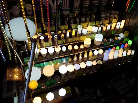 Light bulbs and LED lights are displayed at a hawker's booth in Hong Kong