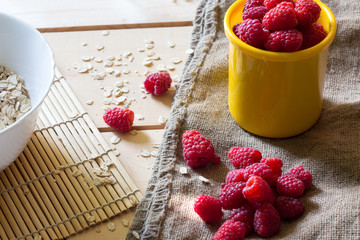 Ripe sweet raspberries on wooden table. Close up, top view, high resolution product