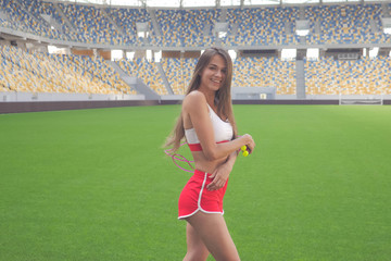 Woman with rope. Sport woman posing with pink rope, helthy activity. Sexy woman with skipping rope. Muscular woman on the Modern football stadium. Sexy sport girl doing exercises on the stadium.