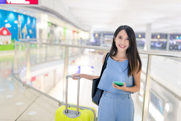 Woman go travel with her luggage