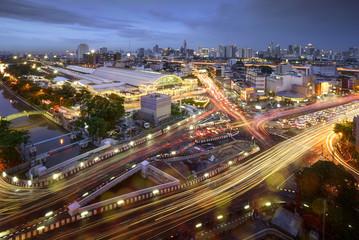 Road traffic at Bangkok city with skyline at night by technic long exposure shoot, Thailand.