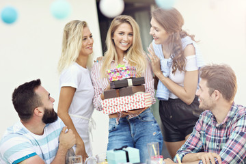 Group of friends having fun at birthday party