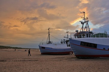 Moody sky over fishing boats at the Thorup Strand, Denmark.