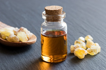 A bottle of frankincense essential oil with frankincense resin