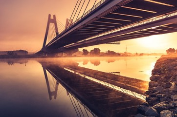 Poster Bridge Cable stayed bridge, Krakow, Poland, in the morning fog over Vistula river
