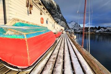 Small fishing boats ashore upon wooden pier-harbor's W.side. Hamnoy-Reine-Lofoten-Norway. 0232