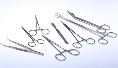 Close Up Surgical instruments and tools on white background. Selective focus.