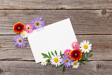 Blank greeting card and flowers