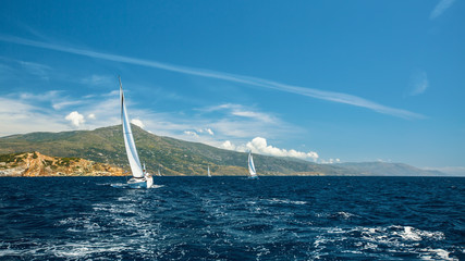 Sailing in the wind through the waves at Sea. Luxury yachts at Regatta.