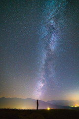 The man stand on the background of the milky way. night time
