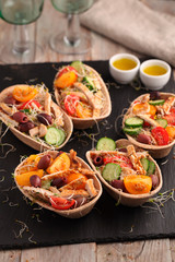 Tortillas with chicken meat and vegetables