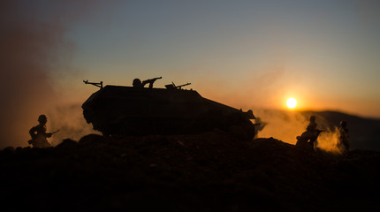War Concept. Military silhouettes fighting scene on war fog sky background, World War Soldiers Silhouettes Below Cloudy Skyline At sunset. Attack scene. German tank in action