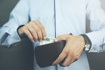 man hand wallet with money